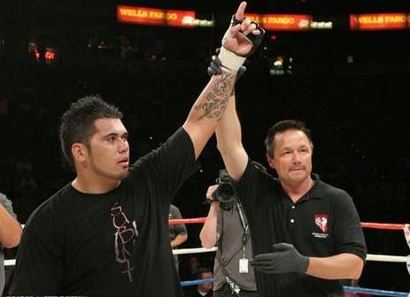 Brice Ritani-Coe's hand raised in victory