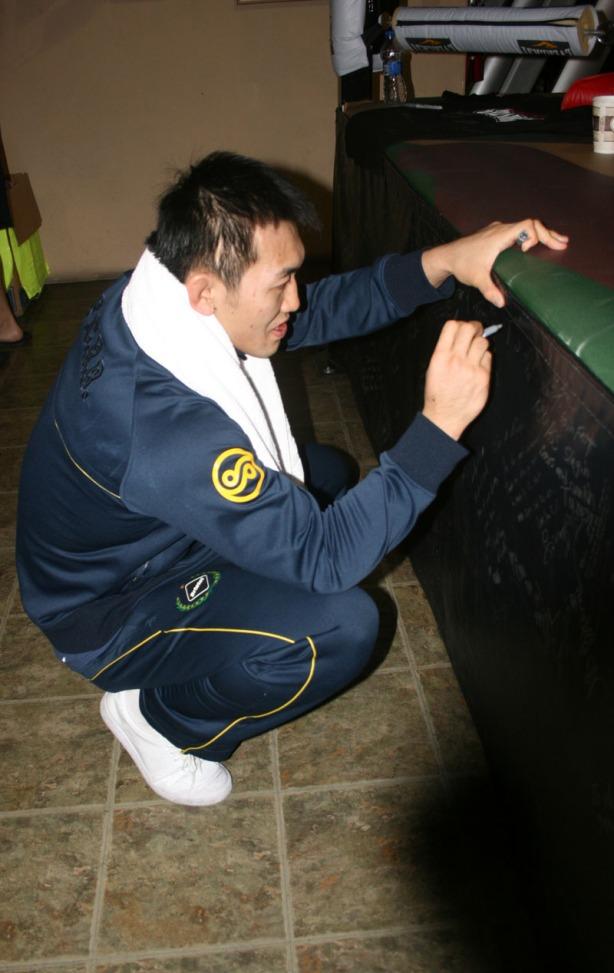 Yoshin Okami_SigningApron